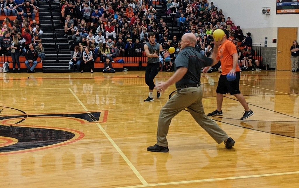 teacher throwing dodgeball